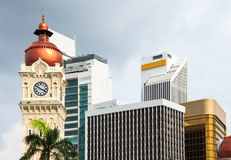 Clock tower of Sultan Abdul Samad building with modern buildings. Stock Image