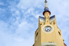 Clock tower on top of apartments in Sitges Stock Photography