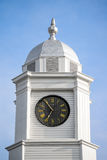 Clock tower on top of a courthouse Stock Photos