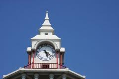Clock tower. Top clock of white tower, Bangkok, Thailand Royalty Free Stock Photography