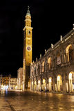 The Clock Tower Torre della Bissara in Vicenza, Italy. This is a night image of the Torre della Bissara located on the Basilica Palladiana in the central Piazza Stock Images