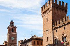 Clock tower and tower of City Hall in Ferrara city Stock Photo