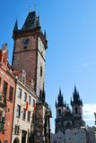 Clock tower and Tyn church in Prague Royalty Free Stock Image