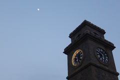 Clock Tower under the moon Royalty Free Stock Image
