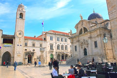 Clock Tower and  Vlaho Church in Luza Square in Dubrovnik, Croat Stock Photos