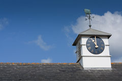 Clock Tower, with weather vane. Stock Photos