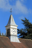 Clock tower and weather vane Stock Photo
