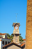 Clock tower with weather vane. View of old clock tower with weather vane, typical 19th century architecture royalty free stock images
