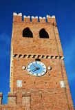 Tower, windows, castle, old walls against blue sky, in Castelfranco Veneto, Italy, Europe. Clock tower, windows, walls, brick castle against blue sky is placed royalty free stock photo