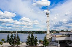 Clock tower of Yaroslavl river station with emblem of city and Volga river. Yaroslavl,Russia- August 07, 2018: Clock tower of Yaroslavl river station with emblem stock photos