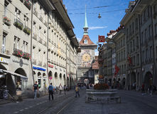 The Clock Tower (Zeitglockenturm) towering over the Marktgasse in Bern, Switzerland Royalty Free Stock Photography