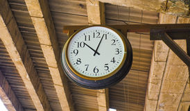 Clock at a train station in Guangzhou. Guangzhou,a clock at a train station, a brown clock with a worn texture background. Use it to represent time, a deadline Stock Image