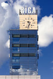 Clock train station in Riga on a background of clouds Royalty Free Stock Photo