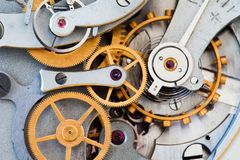 Clock transmission macro view. Stopwatch chronometer mechanism cogs gears wheels connection concept. Shallow depth of. Field, selective focus Royalty Free Stock Photo