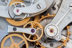 Clock transmission macro view. Stopwatch chronometer mechanism cogs gears wheels connection concept. Shallow depth of. Field, selective focus Stock Photos