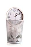 Clock in trash Stock Photo