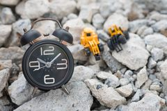Clock and truck toy car construction of pile concrete royalty free stock photos