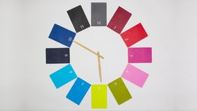 Clock of twelve colored monthly diaries stock video footage