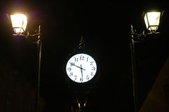 Clock and two sentinels.  Royalty Free Stock Photos
