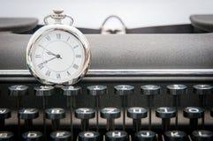 Clock on typewrite Stock Photography