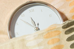 Clock under the covers Stock Images