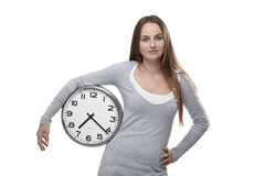 Clock under her arm Stock Images