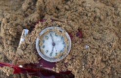 Clock Under Sand Stock Image