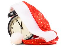 Clock under santa hat Royalty Free Stock Photo
