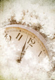 Clock under snow. Clock showing 12 o'clock under snow royalty free stock images