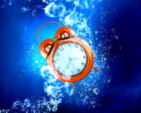 Clock under water Stock Photo