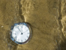 Clock under water. Royalty Free Stock Images