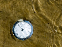 Clock under water. Stock Photography