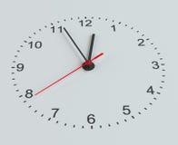 Clock vänder mot Vit bakgrund Royaltyfri Bild