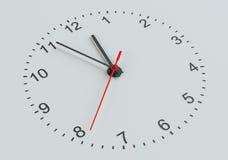 Clock vänder mot Vit bakgrund Arkivbilder