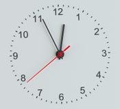 Clock vänder mot Vit bakgrund Royaltyfri Fotografi