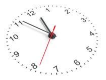 Clock vänder mot Vit bakgrund Royaltyfria Foton
