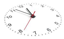 Clock vänder mot Vit bakgrund Royaltyfri Foto