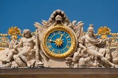 Clock at Versailles palace. Clock at the entrance of Versailles palace in France Royalty Free Stock Photography