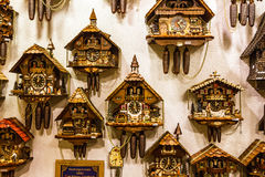 Clock. Vintage cuckoo clocks in shop, Bavaria, Munich, Germany Royalty Free Stock Images