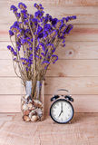 Clock with violet flower on wood background. Alarm Clock with violet flower on wood background stock photography
