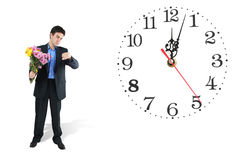Clock and waiting man Royalty Free Stock Photo