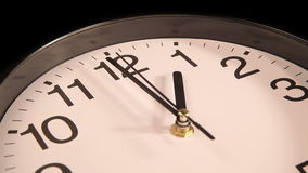 Clock on the wall. Clock black on the wall, 13:00 stock video footage