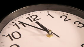 Clock on the wall. Clock black on the wall, 11:55 stock footage
