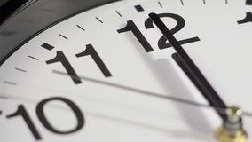 Clock on the wall. Clock black on the wall, 12:00 stock footage