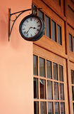 Clock on the wall of a building Stock Images