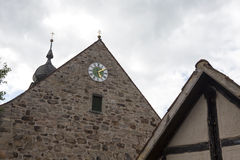 Clock on the wall of a church Royalty Free Stock Photography