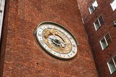 Clock on the wall of City hall in Oslo. Norway stock images