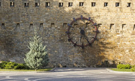 The clock on the wall of the fortress in Baku Stock Photography