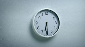 6.30 Clock On Wall. Generic clock on wall showing 6.30 tracking shot stock footage