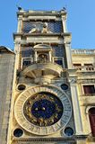Clock on the wall of the house at St. Mark's Square. Royalty Free Stock Photo